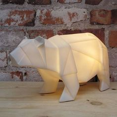 Bathe your room in the gentle glow from this gorgeous origami style polar bear lamp. This sturdy lamp is shaped like a walking polar bear with angular geometric edges, as if made from paper, but is made from sturdy plastic and is mains operated. He'll sit happily on a shelf, table, bedside cabinet, - anywhere in the house! This little chap looks great switched on or off, and the soft light means he works well as a night light too. He would make the perfect finishing touch to a winter scene…