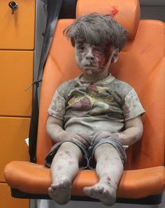 Buried in a bomb blast in Aleppo, Iraq 2016.. here, he was placed in an open ambulance as others attempt rescue others.. he appears to be in shock.