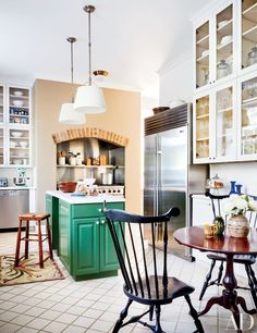 The kitchen of a historic Washington, D.C., home features a brilliant-green kitchen island.