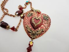 Charming.....and you won't believe it....it's from Dr. Brassy Steamington at Etsy!   Brassy colorized a raw brass heart focal from bsueboutiques.com.....I LOVE THIS!