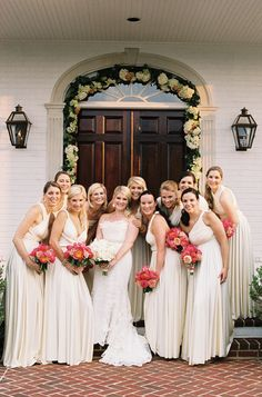 gorgeous gals in cream dresses with coral peony bouquets | Jen Fariello #wedding