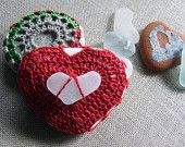 A red heart lying on the pillow multicolor