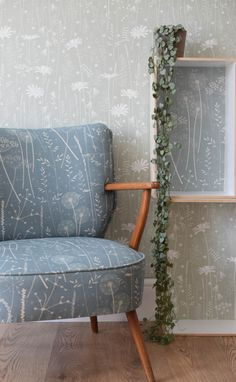 Hannah Nunn: Paper Meadow upholstered chair with Daisy Meadow wallpaper in sage green