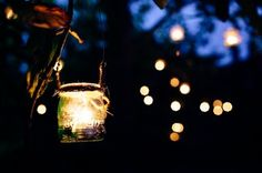 Candles in jars - area around our marquee. www.camelotmarquees.co.uk