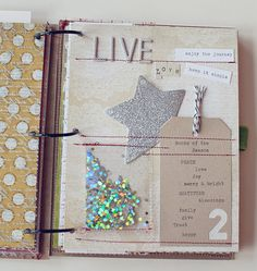 A little bag or pocket of glitter would be adorable for a new years page! You could add it along with a list of resolutions, or use little snowflake confetti and do a general winter page.