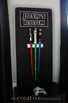 I love this light saber display! However, my son only has one. I could probably hang the one horizontally though.