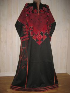 Traditional Syrian wedding dress, characteristic for village of Saraqueb, in North Syria about 65 km South of Aleppo. The dresses from this village are characterized by their large surfaces of red embroidery on dark cotton and their finally worked seams. Themotifs are often geometrical resembling the form of Bedouin jewelry. These throbs were embroidered at the origin by young girls from childhood and used at their wedding. Kalter, Johannes (1992) The arts and crafts of Syria.