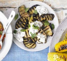 Griddled aubergines with sesame dressing | Dress chargrilled aubergine with tahini, garlic, coriander and yoghurt for a versatile veggie side dish that you can cook on the hob or bbq