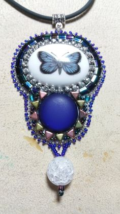 Beaded pendant with polaris cabochon and a beautiful butterfly cabochon made by Alexandra Reiner Etsy shop Chest of Beads Beautiful Butterflies, Butterfly, Pendants, Necklaces, Etsy Shop, Pendant Necklace, Beads, Earrings, Shopping