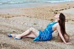 sensual longhaired young woman posing on the beach  Stock Photo