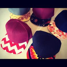 DIY! Take  any color duck bill hat and cover the bill with any fabric and bam! You have your own personalized hat!