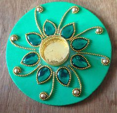 Floating rangoli Tlight holder:)Size 16 CMs . Inbox.https://www.facebook.com/akarshanbangalore/