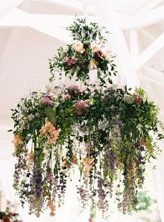 greenery chandelier - photo by Austin Gros http://ruffledblog.com/berry-toned-garden-wedding-splendor