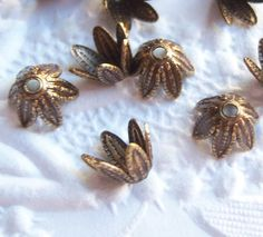 Antique brass leaf petal bead caps, lot of (12) - BV204
