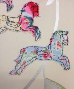 Leanne Fletcher: appliqué, stitch, vintage papers, floral fabric, buttons. ALevel textiles