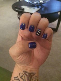 Navy blue with gold studs