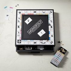 Monopoly | CB2 Black Drawers, Monopoly Game, Game Pieces, Scottie Dog, New Furniture, Cards, Gifts, Dice, Scottish Terrier