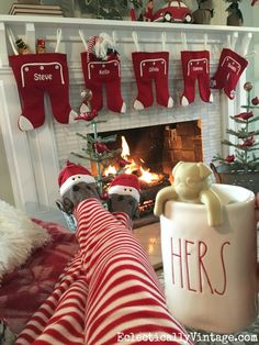 The stockings were hung by this cozy spot by the fire and how fun are these cute sock monkey pajamas - the whole family wears them on Christmas! I love the Hers mug from HomeGoods too eclecticallyvintage.com sponsored pin