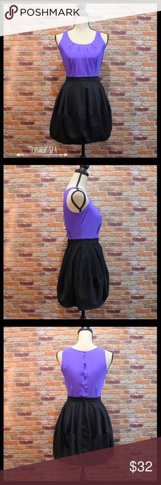"""Topshop Silk Bodice Two Toned Dress W/Pockets Topshop two toned dress in a size 4.  Top is 100% silk in a purple color with four covered buttons down the back.  Skirt and waistband are black with pleats, has two pockets, and is a bubble skirt.  Measures 17"""" armpit to armpit, 12 1/2"""" flat lay waist and 30"""" in length. 100% silk top and 100% cotton skirt.  In like new condition. Topshop Dresses Mini"""