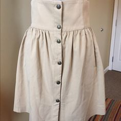 High waist skirt that flows out! Zara tan, button up front, high waist skirt! Perfect with a tank, tee, or blouse! Never worn. Says size M or 28 Zara Skirts