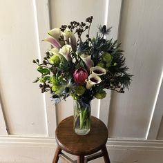 Made this flower arrangement with protea, lisianthus, calla lily, thistle and eucalyptus
