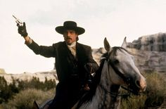 Dennis Quaid as Doc Holliday in the 1994 fim Wyatt Earp. I loved that the filmmakers put Doc on a grey horse, but somehow I don't think his little pistol will help him shoot the cowboy gang in quite the way they intended.