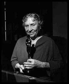 """Helen Keller holds her Oscar award for the documentary, """"Helen Keller In Her Story"""", circa 1954."""