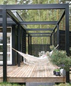 Side view of the black and white sunroom deck house.