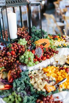 Beautiful fruit and cheese display with a rustic lantern.  Abby and John Signature Images  Photo By Heather Hawkins Photography