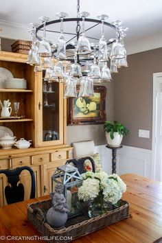 Dining Room by Craigslist With a Wine Glass Chandelier