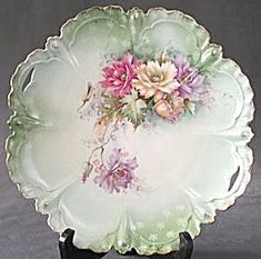 Vintage Hand Painted Poppy Serving Plate: Cake plate with scalloped shape edge & blown out drop design along edge, gold trim & raised gold dots in flower centers. Poppies are done in lavenders, soft apricots and carnation pink. All have a translucent quality to them. Lots of detail. Cut-handles.