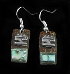 Fine earrings of pewter Aztec design incrustation on coconut with abulone shell.    Wide : 1.2cm = 0.5 inches    Large: 2.5cm = 1 inches