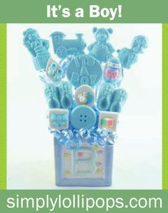 """The combination of baby-themed lollipops centered with an """"It's a Boy"""" announcement lollipop is the perfect, sweet gift--especially for newborns with siblings to help taste test.  Thirteen delicious cotton candy and marshmallow lollipops adorn a cute ceramic base marked with a """"B"""".  Lollipop shapes such as baby shoes, delivery storks, and baby toys help create this memorable baby lollipop bouquet."""
