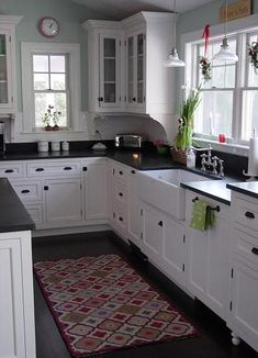 I love a white kitchen with different colors.