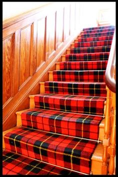 Tartan Stairs - an interesting thought and an expensive way to use a plaid.  Definitely needs the wood wainscotting to set it off.