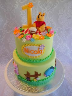 Winnie the Pooh's Picnic - A vanilla cake with caramel filling for a first birthday celebration.