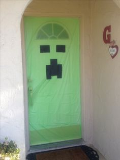 Dollar store tablecloth and construction paper = creeper front door. - Minecraft party
