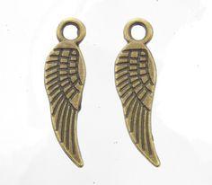 18x5x1mm Antique Brass Base Metal Wing Charm/Pendant - Qty 10 (G420) by beadsandbabble on Etsy