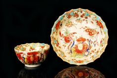An 18th Century Worcester teabowl and saucer decorated in the Jabberwocky pattern, in the Rich Kakiemon style with a turquoise blue border, painted fret mark, circa 1765