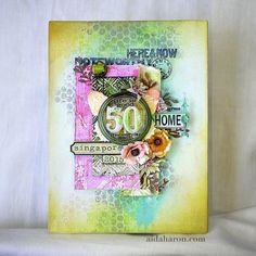 Aida Haron with a garden canvas using Tim Holtz, Ranger, Idea-ology, Sizzix and Stamper's Anonymous products; Aug 2015