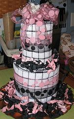Dish towel cake for a wedding shower gift! Hot pads were used to bulk up the middle of each layer.