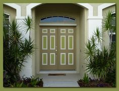 Two toned door for the front door. I like it. & This entryway looks fresh and inviting with its neutral wall and ...