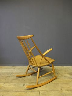 Danish Rocking Chair  A beautiful sculptural piece, displaying great curves and craftsmanship. Made in Denmark circa 1950-60  Designed by - Illum Wikkelso Manufactured by - Niels Eilersen  Beech construction The chair is in good solid condition showing some minor age related wear 580mm Width 740mm Depth 920mm Height 420mm Seat Height  A great statement piece for your home.  Delivery usually ranges between £25 - £45 within a 100 mile radius of London Please ask for a quote.  Collection for…