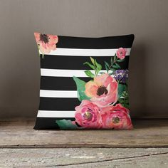 This beautiful and elegant Black & White Stripes Floral throw pillow will make any space in your home look amazing. This is the perfect accessory for any couch, living room, window seat, bedroom or an
