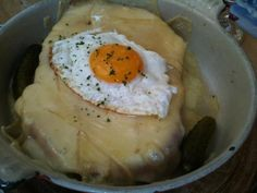 Croûte au fromage, my favourite Swiss delicacy! Stale bread, wine, pickles, eggs and loads of cheese.