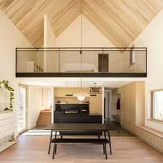 One of the ways in which Handa made the interiors feel more spacious was to create a double-height living space that is open to the primary bedroom. Built as a mezzanine, this configuration makes both rooms feel larger. Kitchen Designs Photos, Modern Kitchen Design, Interior Design Kitchen, Light Hardwood Floors, Concrete Floors, Clad Home, Studio Build, Wooden Cottage, Shared Rooms