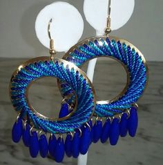 Boutique Fashion Earrings Two tone blue stitched circular earrings on gold tone metal with dangling ivory beads.  3.5 inches and lightweight. Jewelry Earrings