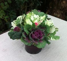 Seasonal Potager Centerpiece  Using ornamental cabbage, garlic blossoms, watermelon radishes, artichokes.