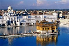 Golden Temple of Amritsar India. The most sacred shrine for Sikhs, rises from the center of a lake in Amritsar. Temple D'or, Temple India, Travel And Tourism, India Travel, Jaipur, Beautiful Buildings, Beautiful Places, Peaceful Places, Beautiful Architecture