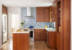 How cheerful is this space?! We'd move right in, if we could. Featured here, the Showplace Milan door in eucalyptus Autumn. Thank you, Jan Goldman of Kitchen Elements, for such hard work and dedication in Maryland.  Kitchen Elements: http://www.kitchenelements.com/ Houzz: http://www.houzz.com/projects/1403412/silver-spring-kitchen Showplace Wood Products: http://www.showplacewood.com/